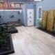 Tuinaanleg keramische tegels voegwerk en stapelblokken met tuinperken Haarlem